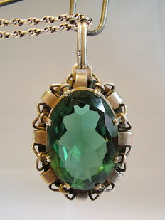 Large pendant with large forest green spinel of 30 ct