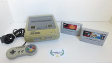 Super Nintendo console with controller & 2 games