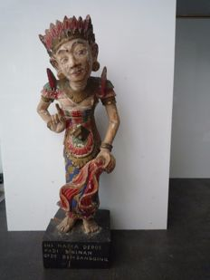 Polychrome wooden statue with text, Bali, Indonesia