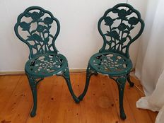 2 very decorative metal chairs