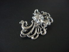 Art Nouveau silver brooch with an embossed relief of a woman's head
