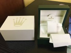 With Rolex box and outer packaging.