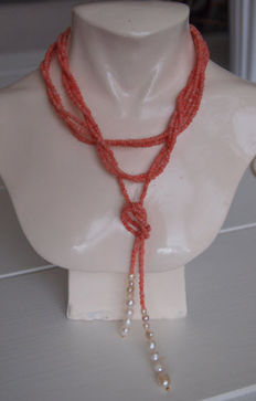 Necklace with 3 strands of natural angel skin coral and freshwater pearls