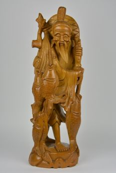 Wooden sculpture of a carp fisherman - East Asia - End of the 20th century