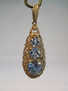 Pendant with light blue spinels