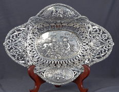 Large silver bread basket with decor of playing children with chicks and romantic scene, Germany, 19th or 20 century