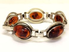 Silver, Fishland bracelet with oval amber, in open setting.