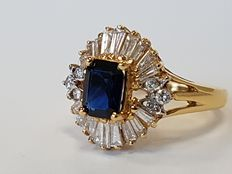 Gold and sapphire ring with an entourage of baguette-cut diamonds
