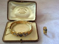 Patriotic jewellery from the period of WW I Bracelet in its original box and a ring made of artillery shell guide rings