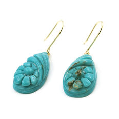 Yellow gold earrings with pear-shaped turquoises with floral design inside.