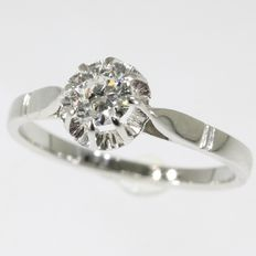 Solitair diamond engagement ring in Art Deco style made in the fifties