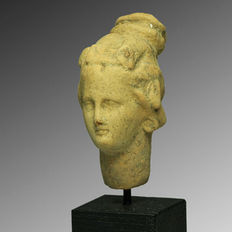 Terracotta head of a Hellenistic figurine - 6 cm