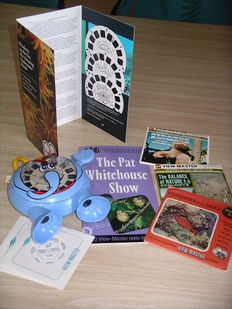 "A beautiful View-Master lot (1954-2007) with stereo photos of nature: butterflies, birds, underwater, flowers. Plus an ""elephant viewer"""