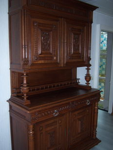 Oak dresser with wood carvings, ca. 1920