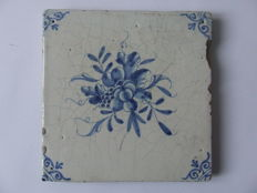 Antique tile with a so-called piece of fruit
