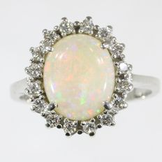 Stylish ring with diamonds and one big natural opal - anno 1950