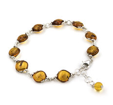 Bracelet with oval design made in silver with amber stones.
