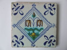 Coloured square tile with snake's head flower