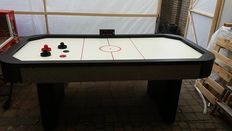 Air hockey table with electronic scoring including accessories.