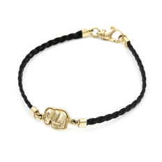 Yellow gold bracelet with elephant design and braided black leather.