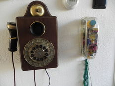 2 Telephones: 1 transparent and a wooden telephone