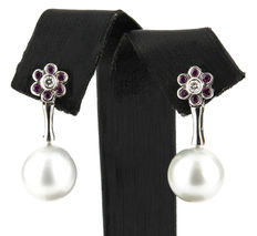White gold flower-shaped earrings with central diamonds, rubies and South Sea Australian pearls with a diameter of 11 mm