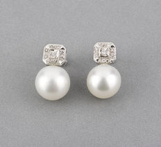 White gold earrings with brilliant cut diamonds in square settings and Australian South Sea pearls