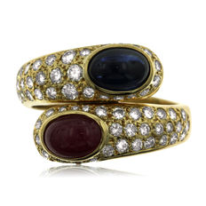 Diamond, Ruby and Sapphire 'Twist' Ring, As New. - Ring size: 50.5-16-K (UK)