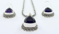 Sterling silver (925/1000) chain and sterling silver handmade pendant and earrings with large amethysts.  Origin: Bali