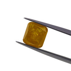 Natural Fancy deep orangy yellow 2.60 ct. cushion shape diamond. AIG Certified