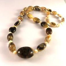 Baltic amber, 100% natural olive shaped beads, egg yolk and dark / white colour, 34.2 grams
