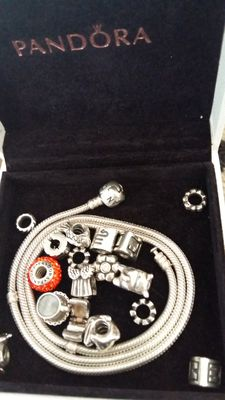 Pandora necklace with 18 charms in original box, 51 cm