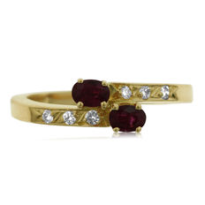 18k. Ruby and Diamond 'Twist' Ring, as new. Ring size: 53-17-N (UK)
