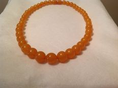 Amber necklace with orange/yellow beads, from the 1930s, approx. 33 grams