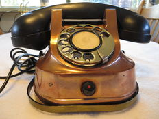 Two beautiful copper telephones