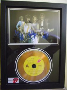 The Rolling Stones, signed( printed facsimile signatures )framed photo, and gold record effect CD disc presentation.