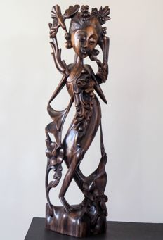 Dancer with lotus flowers and birds, with inscription – carved Coromandel wood – Bali – Indonesia