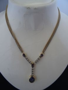 14 karat gold necklace with tanzanites and 0.56 ct diamonds.