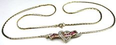 Diamond ruby heart necklace 14kt/585 yellow gold, necklace length 46.0cm.