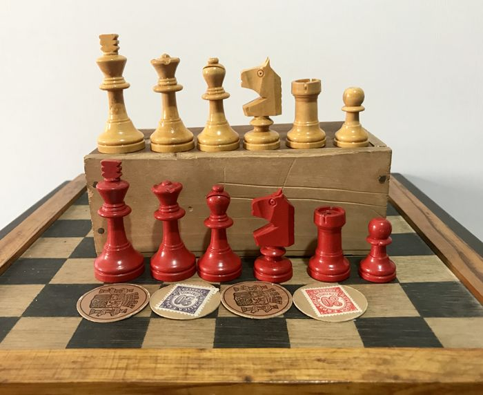 Antique Staunton chess set with coin seals of the Spanish