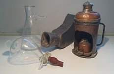 Antique medical nebulizer in copper, antique pewter  urinal and glassware of laboratory quality.