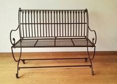 Large wrought iron bench