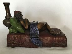 Sculpture; Nude woman on Persian carpet bed - 21st century