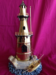 Vintage lighthouse and boat in bronze