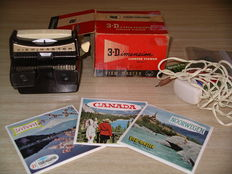 "View-Master Lighted Stereo Viewer Model ""F"" from 1958 with demo reel and with three countries packets"