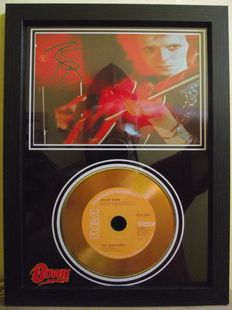 David Bowie, signed( printed facsimile signatures )framed photo, and gold record effect CD disc presentation.