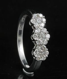 18 Kt. white gold three clusters classy ring set with brilliant diamonds 0.51 ct., G colour and SI clarity in a intricate presure setting Size 54/N (free resizing in Antwerp)