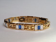 Gold bracelet with natural sapphire, Blue and White Topazes