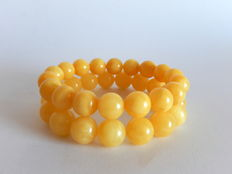 Two Baltic amber bracelets in yellow opaque colour, 31 gram