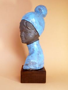 P. Serste - terracotta bust of a girl with a hat